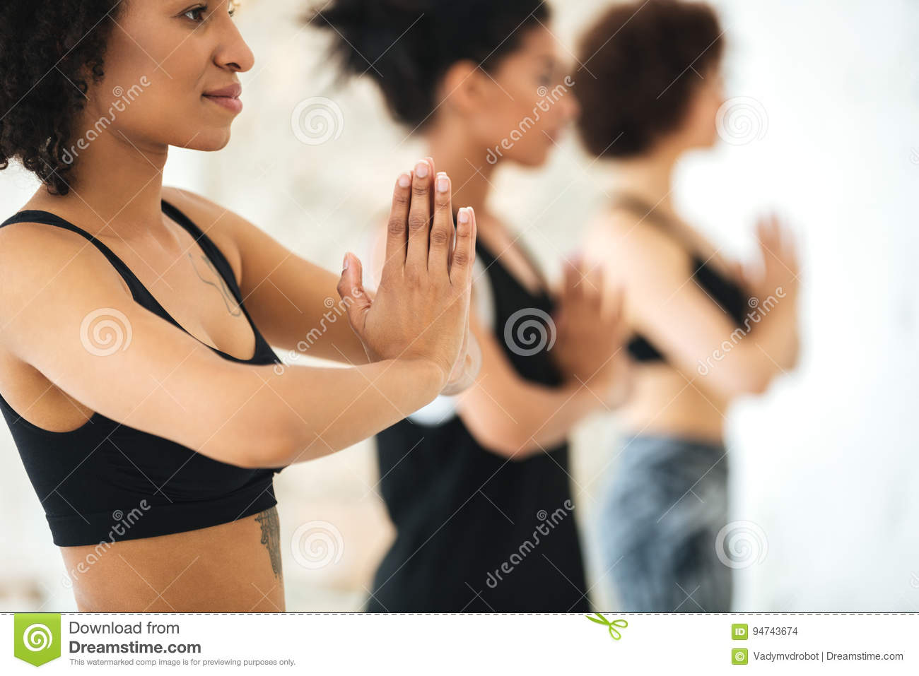 Close up of multicultural group of women practicing yoga