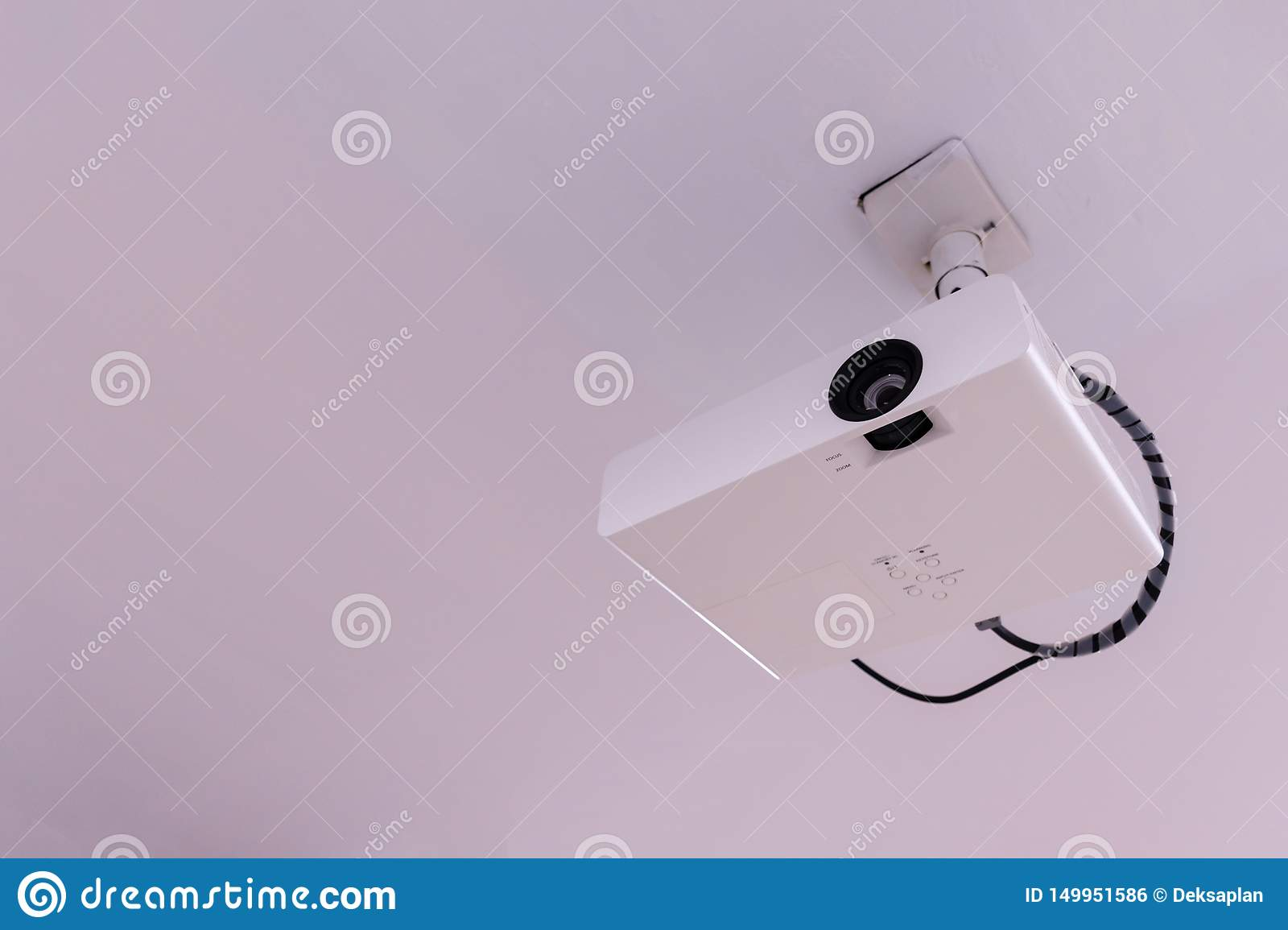 Close up Multimedia projector installed on the ceiling