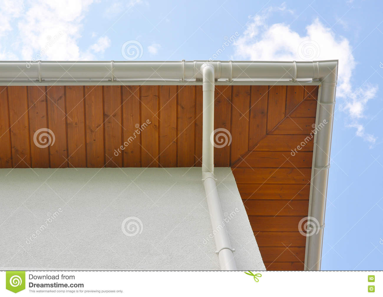 How to install a downspout in a gutter - Royalty Free Stock Photo