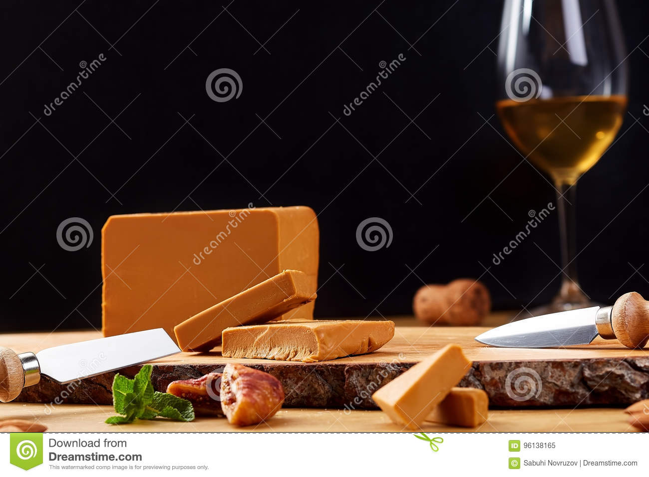 Close-up Of A Norwegian Gudbrandsdalen Cheese With Glass Of