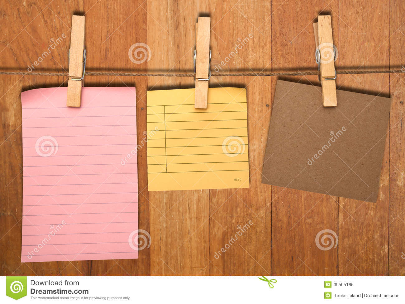 Close up of a notes and a clothes pegs