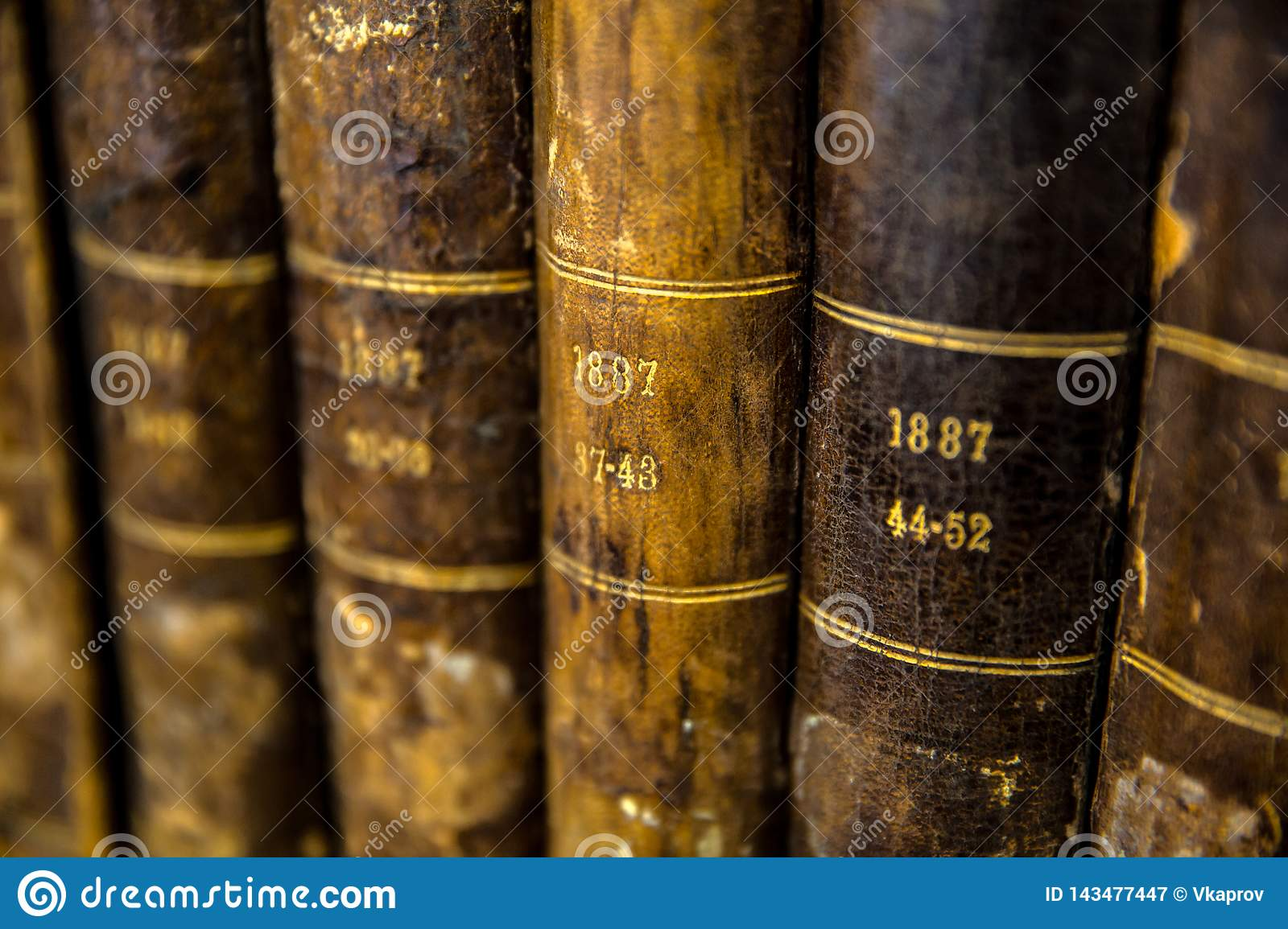 Close-up of a number of very old books.