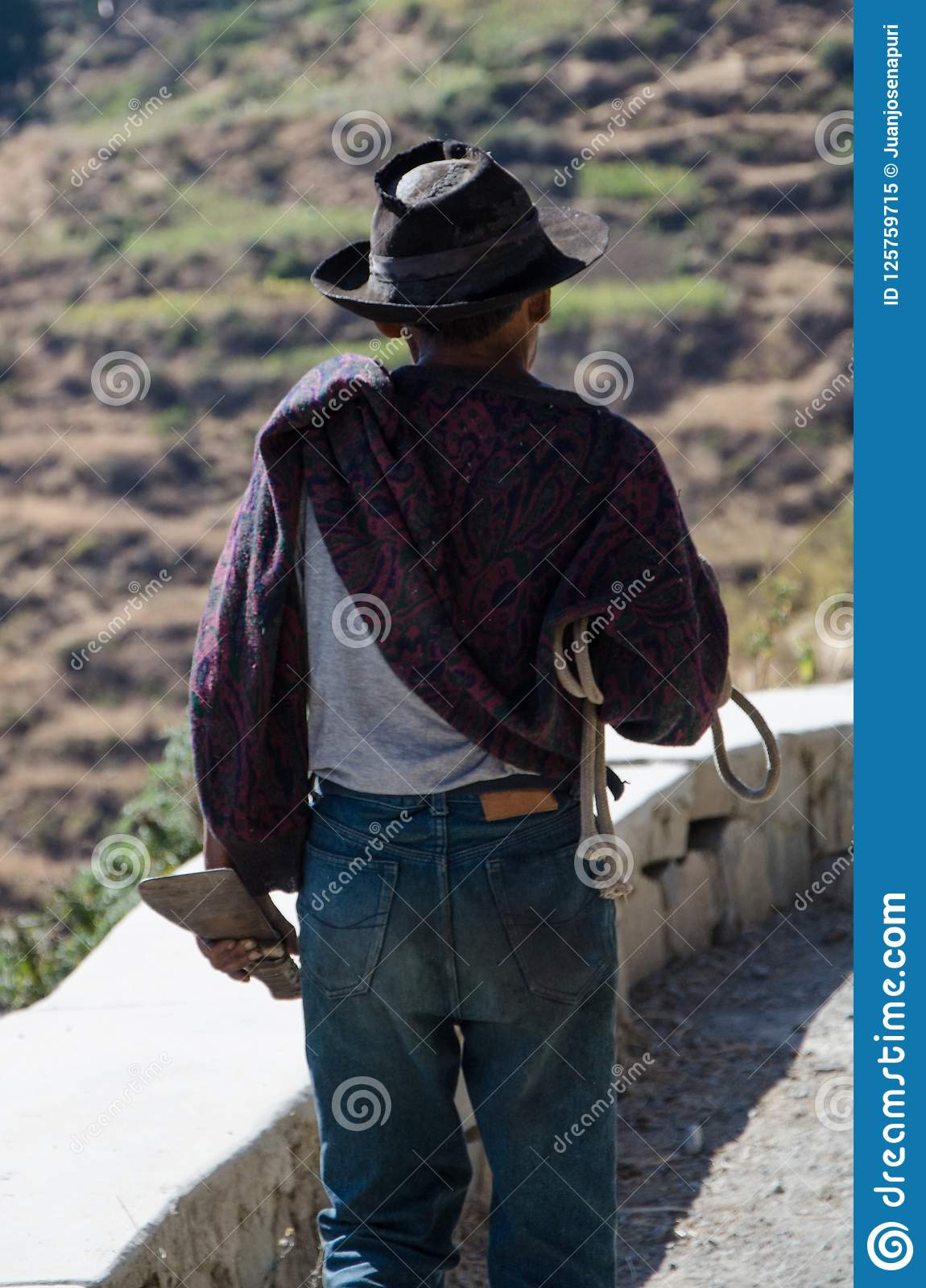 Close-up Of Old Farmer With Hat Walking With A Knife Stock