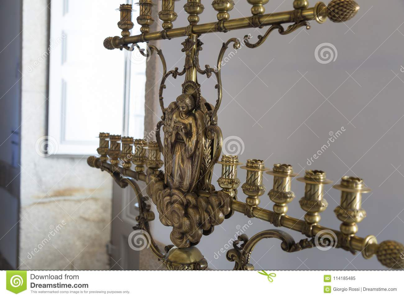 Close up of Old Golden Candlestick with Religious Decorations
