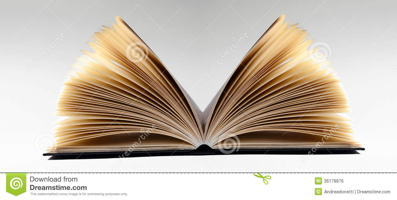 close up of an open book on gray background stock photo image  royalty stock photo