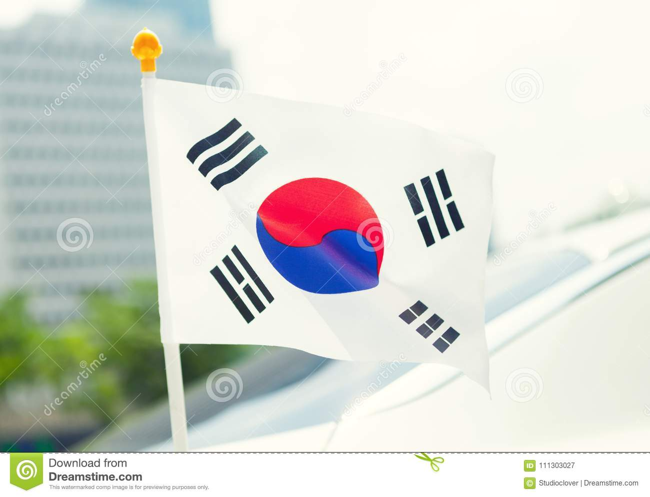 close up ourdoors shot of south korean flag on a flagpole stock