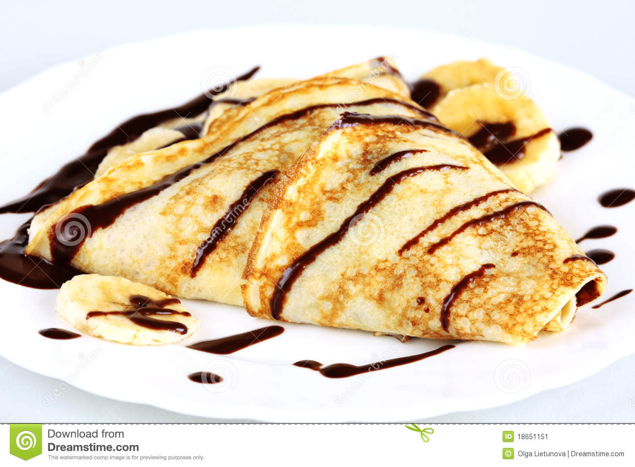 Close-up pancakes with bananas and chocolate