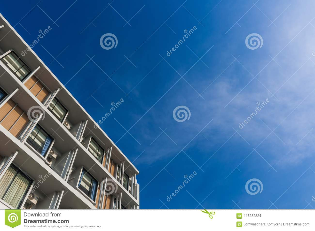 Close up part of condominium modern style on blue sky background