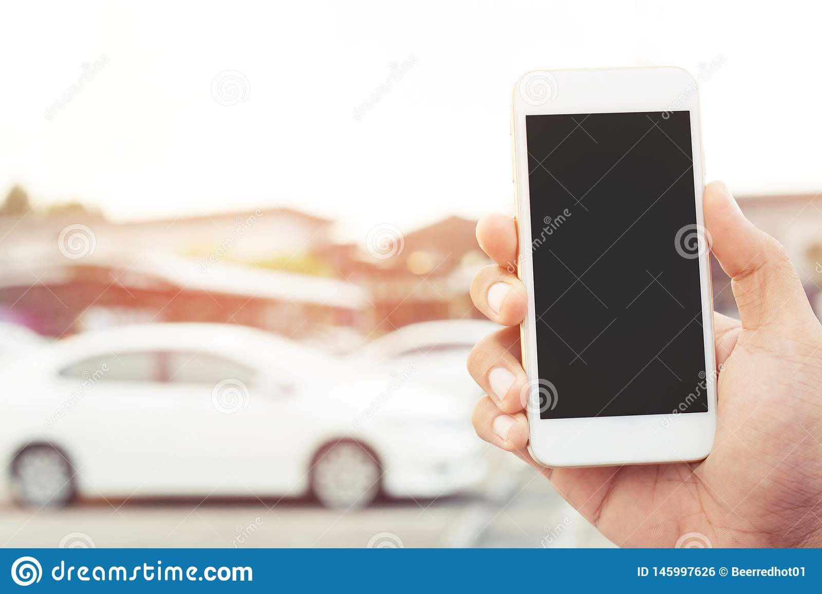 Close up people man hand using a mobile smart phone call a car mechanic