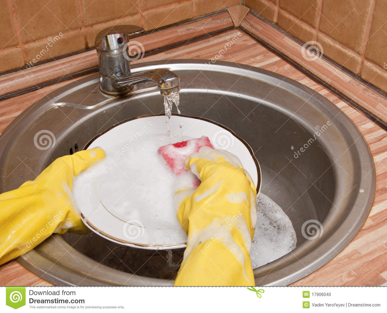Close Up Of A Person Washing A Plate Stock Photo Image
