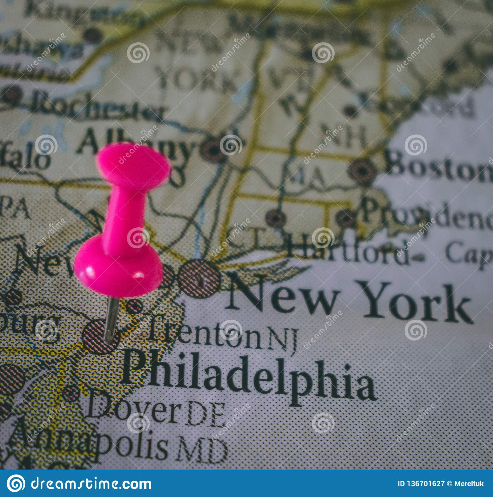 Close up of Philadelphia pin pointed on the world map with a pink pushpin