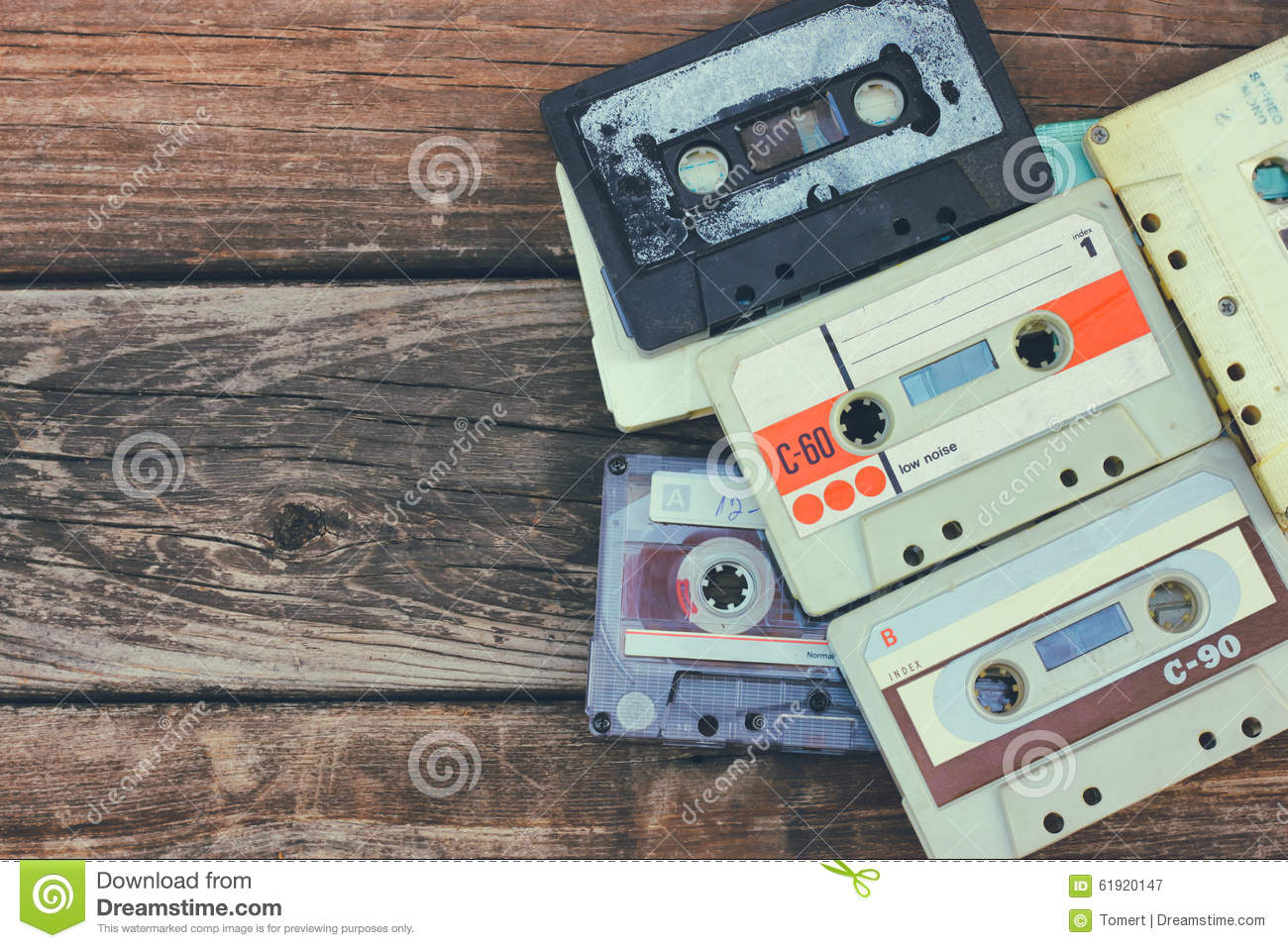Close Up Photo Of Cassette Tape Over Wooden Table Top View Retro Filtered