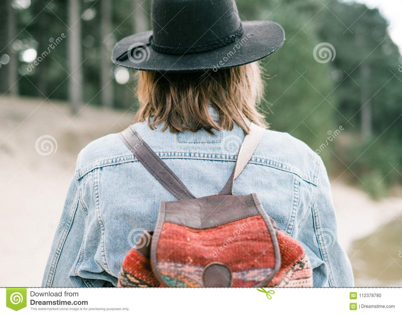 Close Up Photo Of A Denim Jacket On A Young Woman Stock Photo