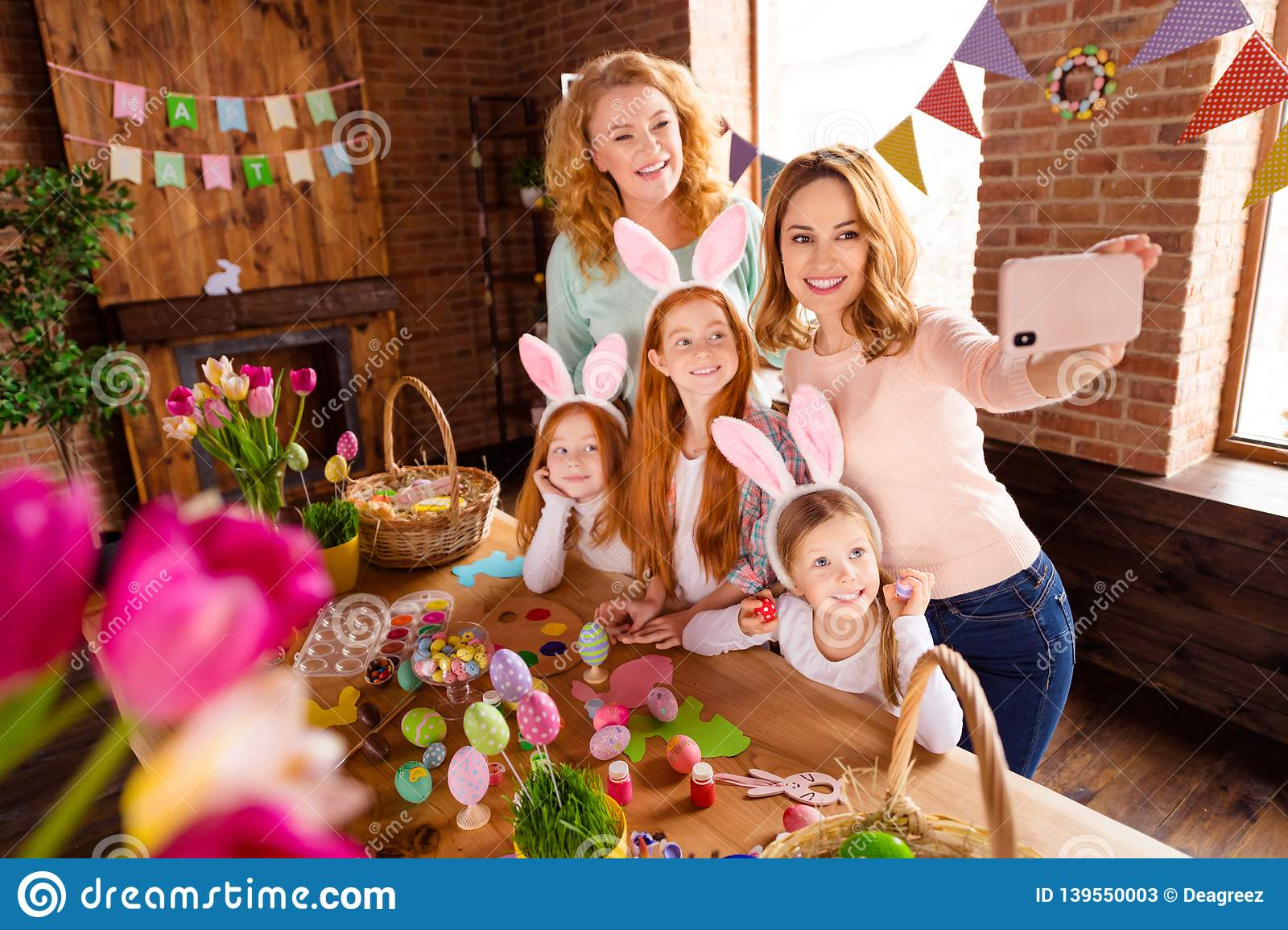 Close up photo foxy three small girls children day easter two mommy pretty table full handmade craft big wooden have