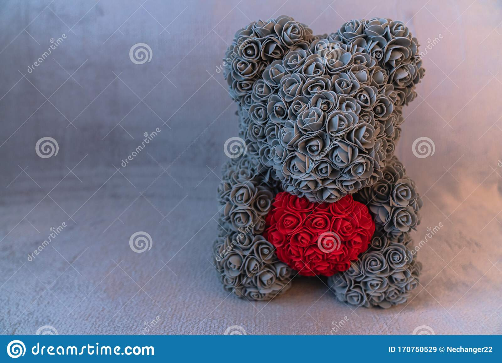 Crochet teddy bear holding a heart - Amigurumi Today | 1156x1600