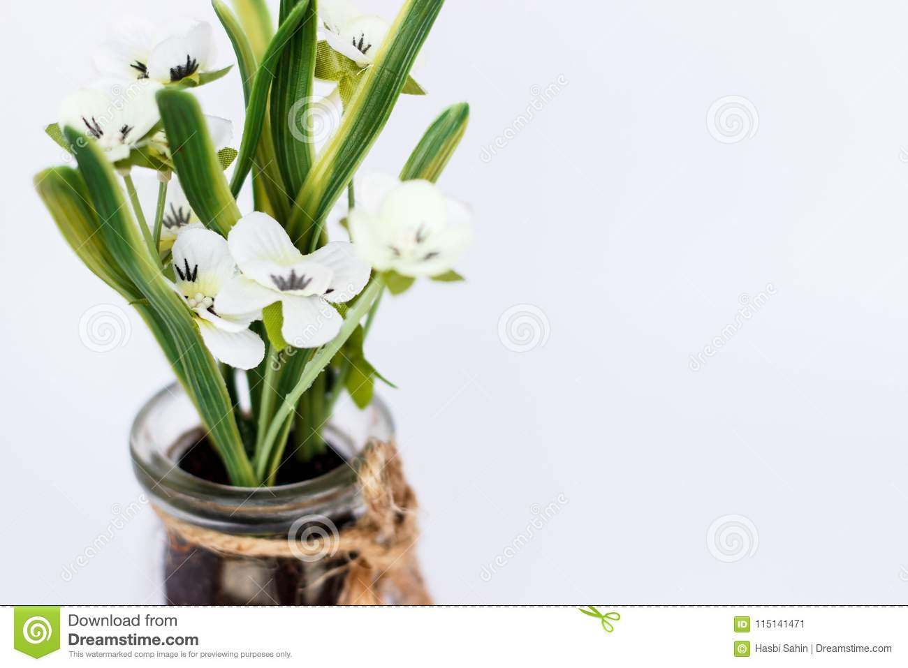Isolated White Plastic Flower In Glass Jar Close Up Stock Image