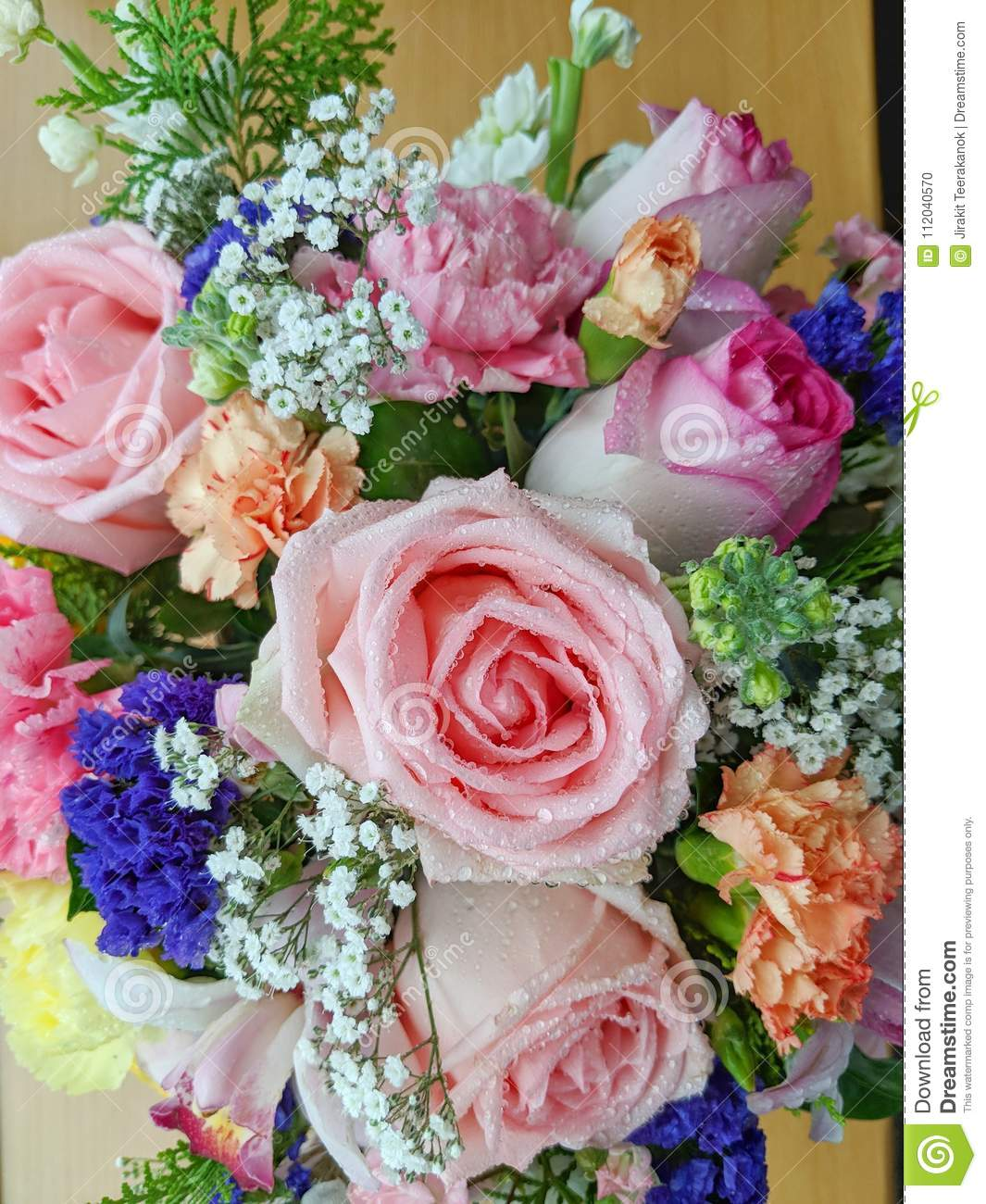 Close Up Photo Of Pink Flower Bouquet On A Wooden Board The