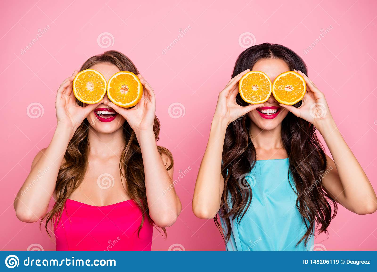 Close up photo two people beautiful she her ladies hands arms hold hide eyes specs organic nature fruits party festive