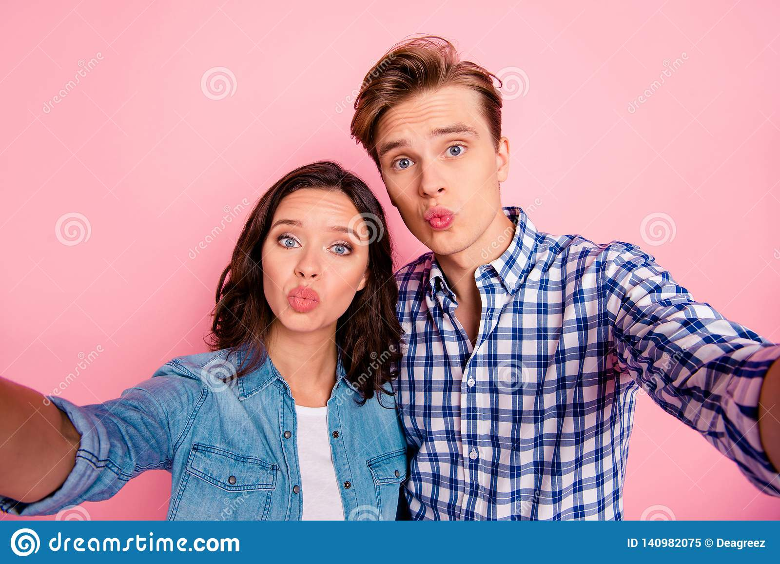 782b06181b248 Close up photo of video call she her he him his pair taking making selfies  sending air kisses to everyone wearing casual jeans denim plaid shirts  isolated ...