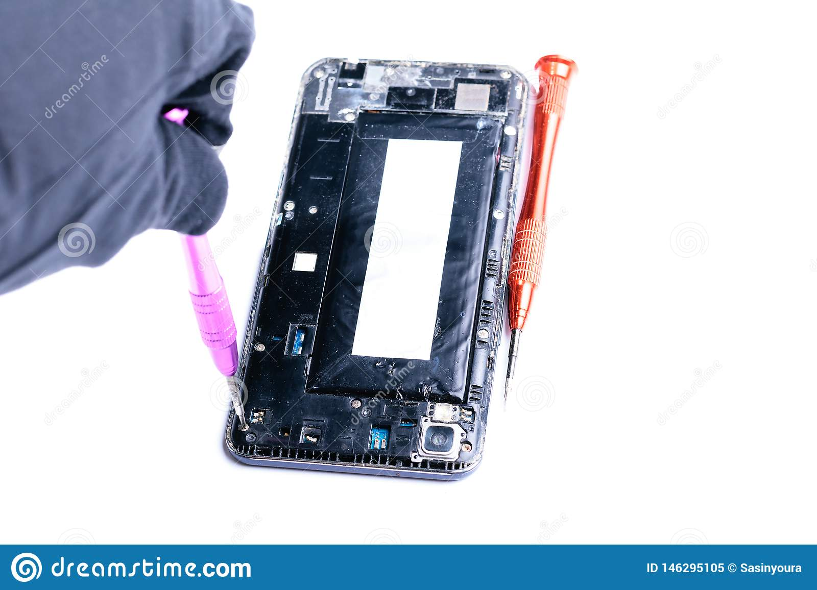Photos showing the process of repairing a broken mobile phone with a screwdriver in the laboratory for repair of mobile equipment