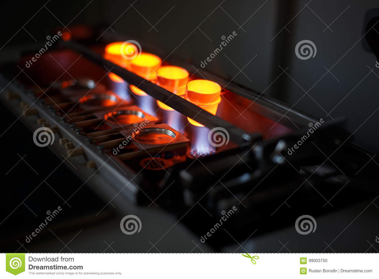 Liquid steel melting on a furnace on a dark background. Technology for roasting metal. Industrial metallurgy equipment.