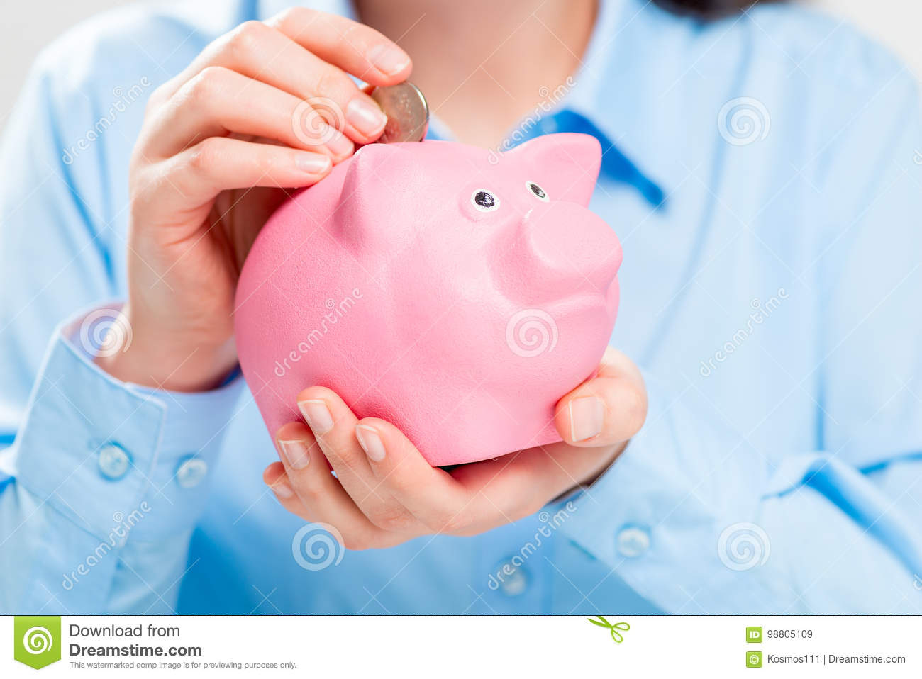 Close-up of piggy bank pig and coins