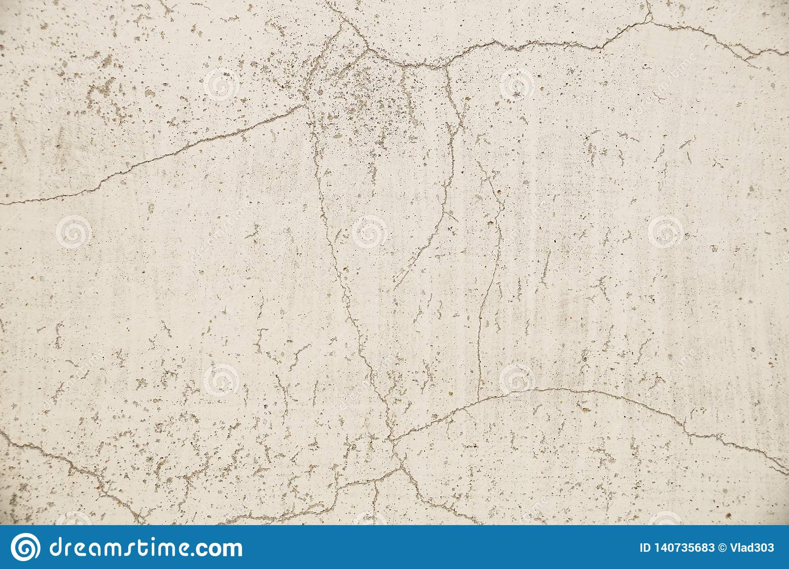 Close-up on a plastered painted wall. Light gray, old, cracked wall surface