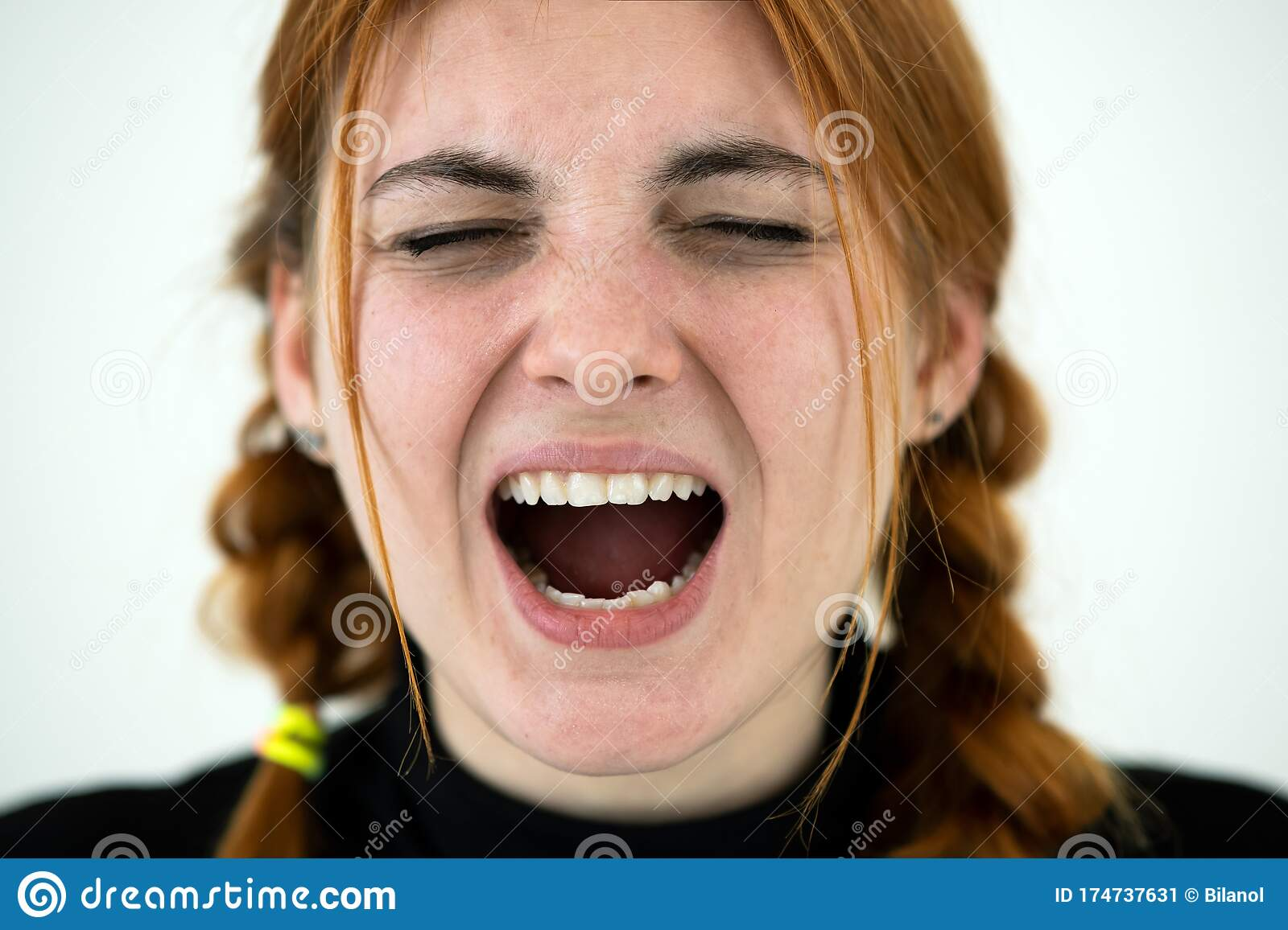 Close Up Portrait Of Angry Redhead Teenage Girl Stock
