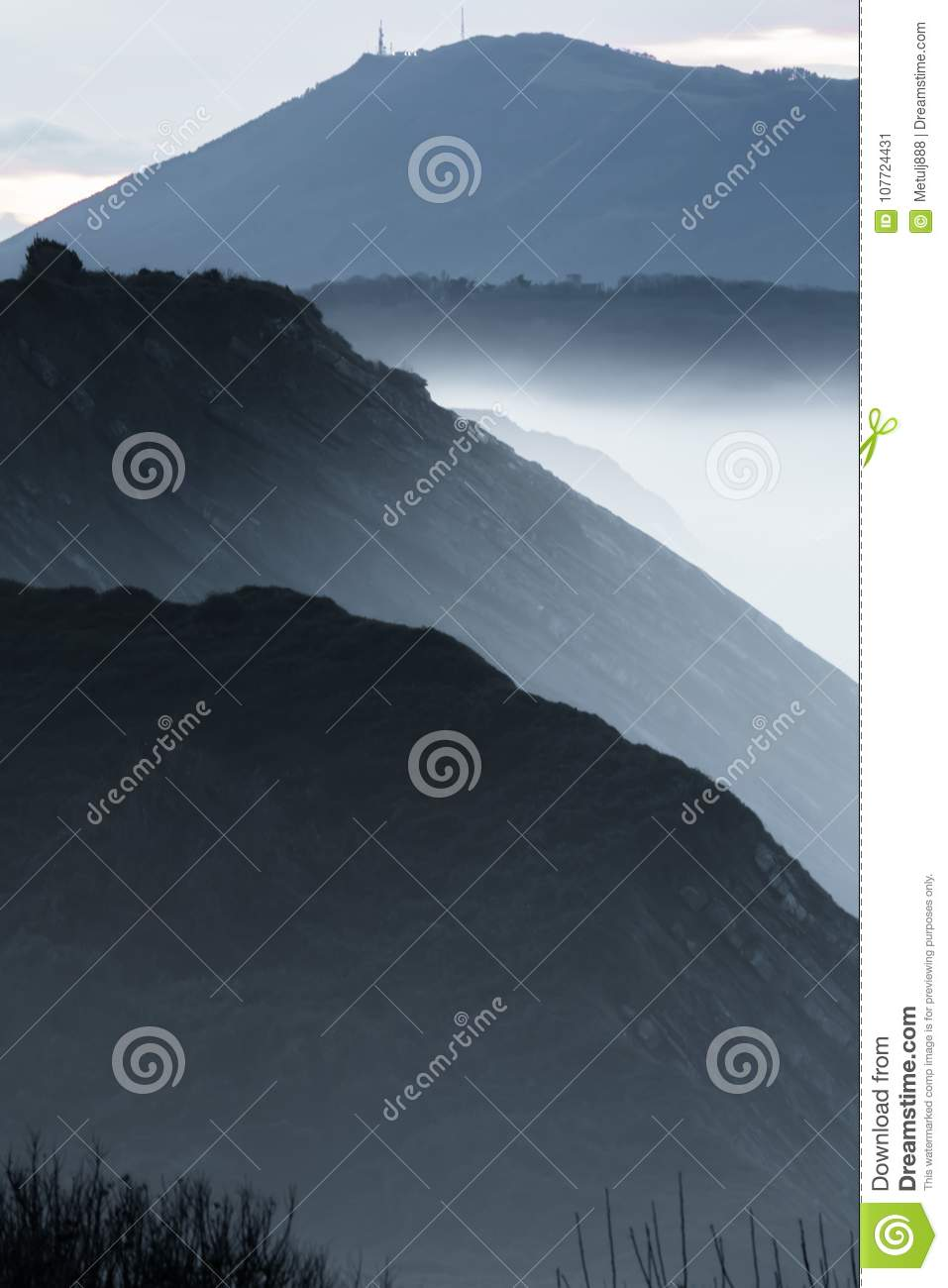 Close up portrait of beautiful landscape layers in twilight on atlantic coastline in shades of grey, basque country, france