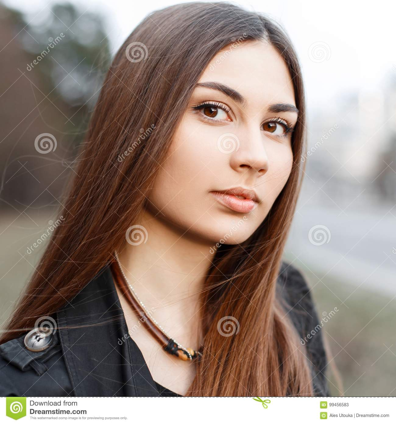 Close-up portrait of a beautiful young girl with amazing brown e