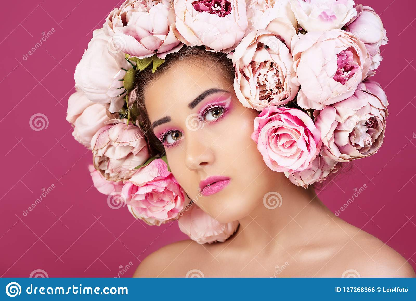 Close up portrait of beautiful young girl with pink roses flower on head and make up