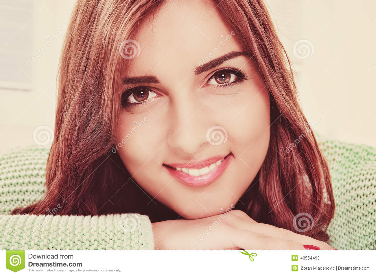 Close up portrait of beautiful young happy smiling woman