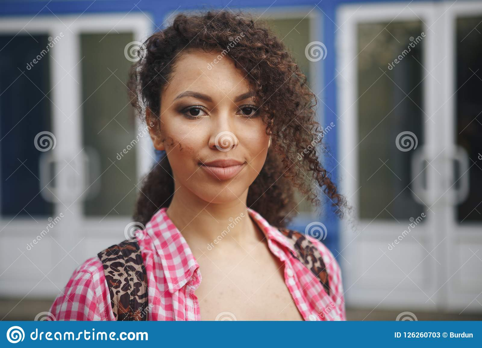 Close up portrait of a beautiful young woman with curly hair