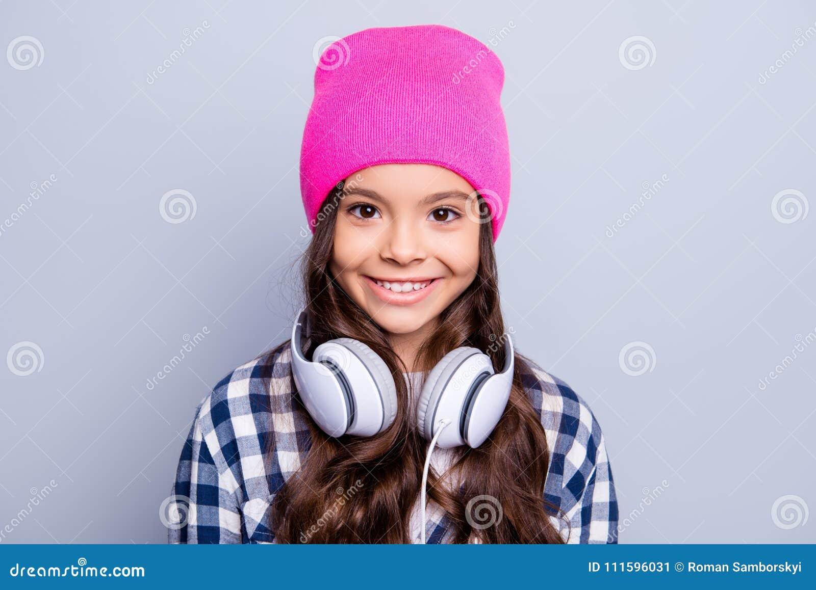 Close up portrait of cute charming little girl having earphones