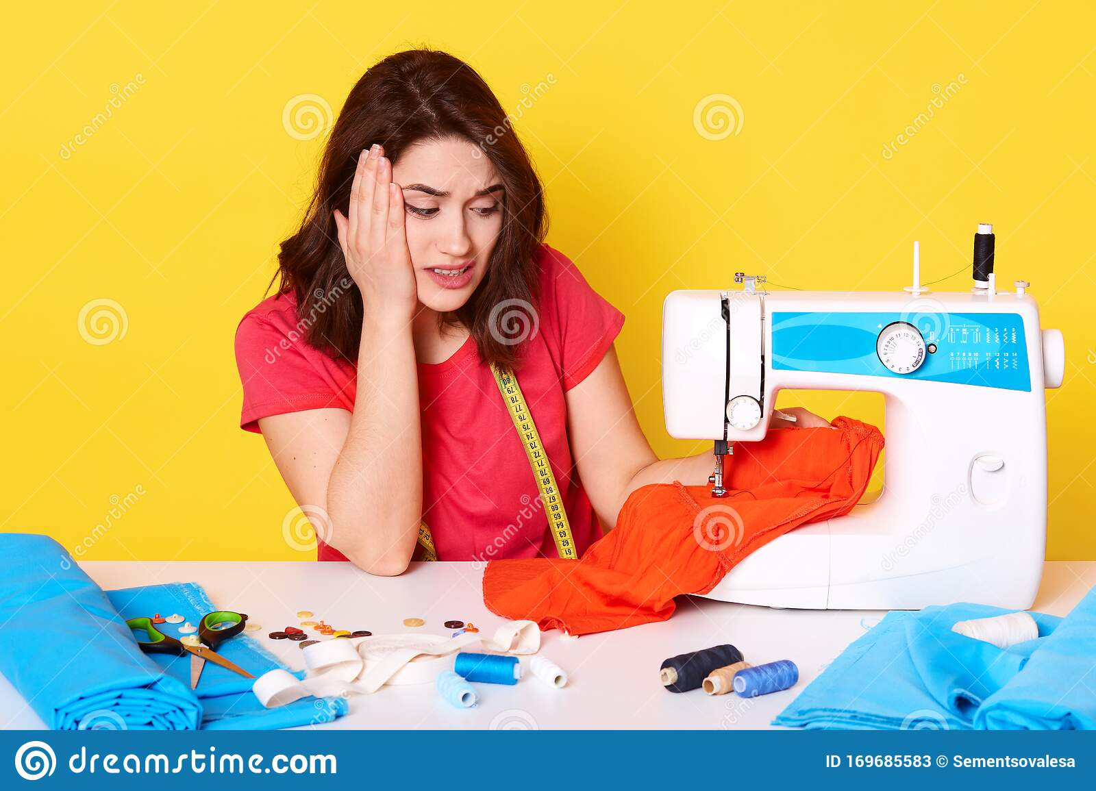 Close Up Portrait Of Fashion Designer Have No Idea When Designing New Collection Of Dress In Workshop Studio Looking At Piece Of Stock Image Image Of Exhausted Sewer 169685583