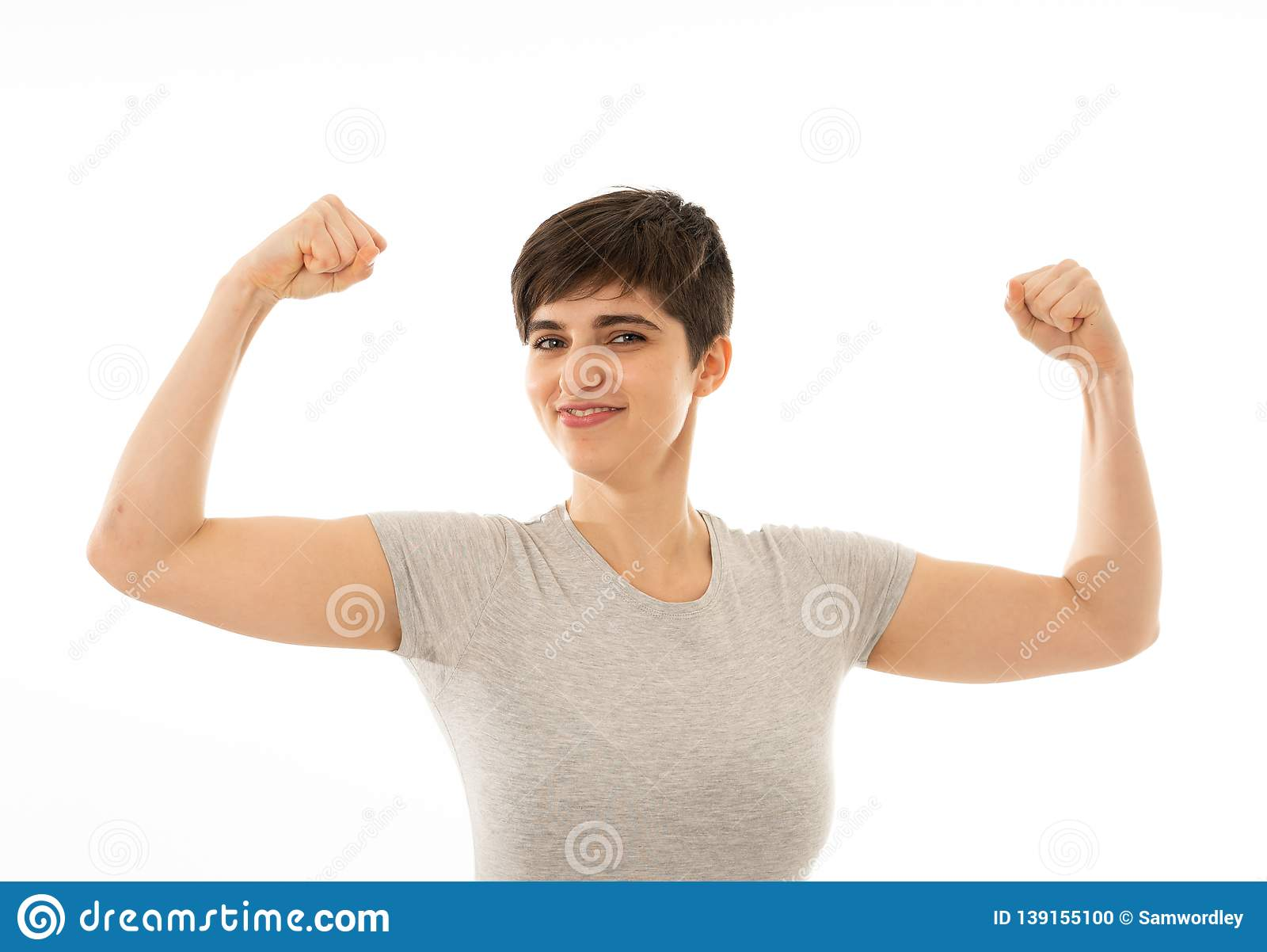 Close up portrait of funny strong smiling and laughing attractive woman in happy face and fitness