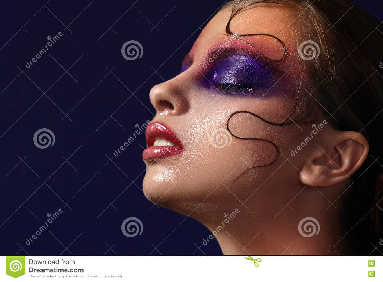 Close Up Portrait Of Girl With Purple Makeup On Eyes Stock Photo