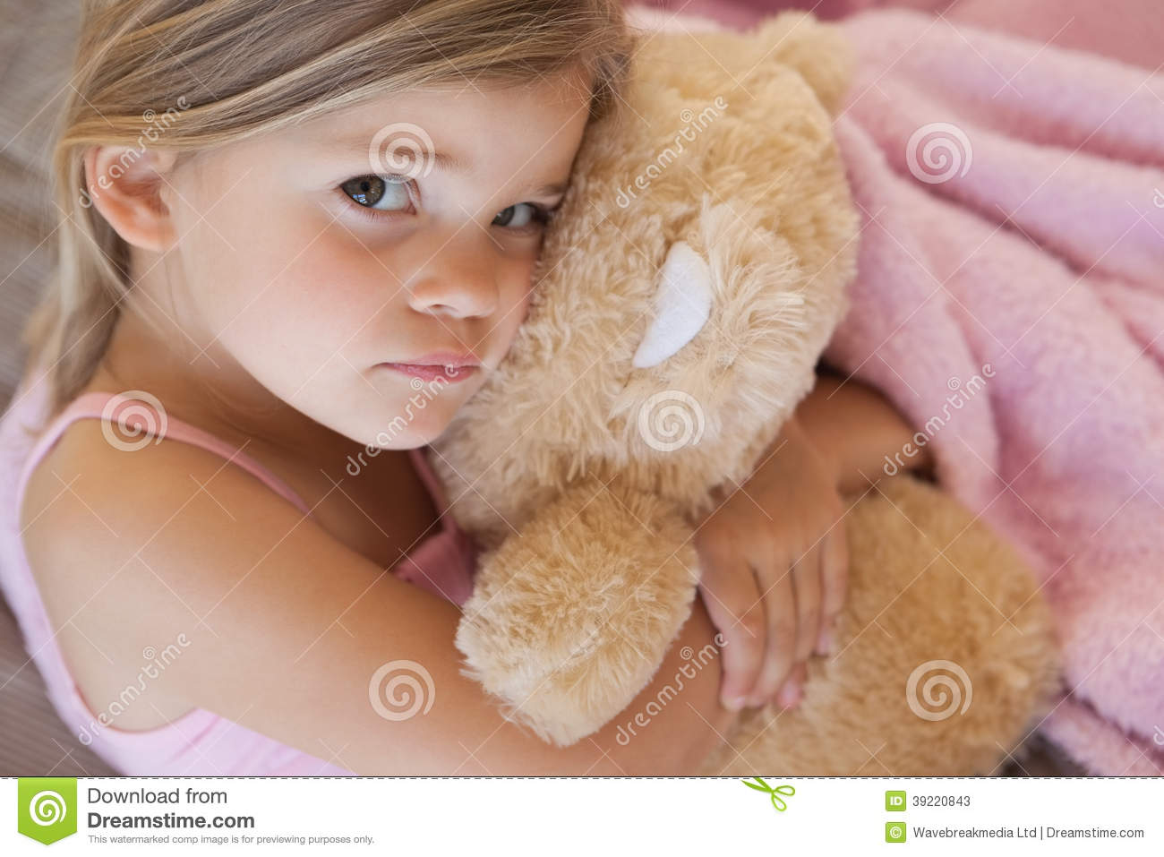 Close-up portrait of a girl with stuffed toy