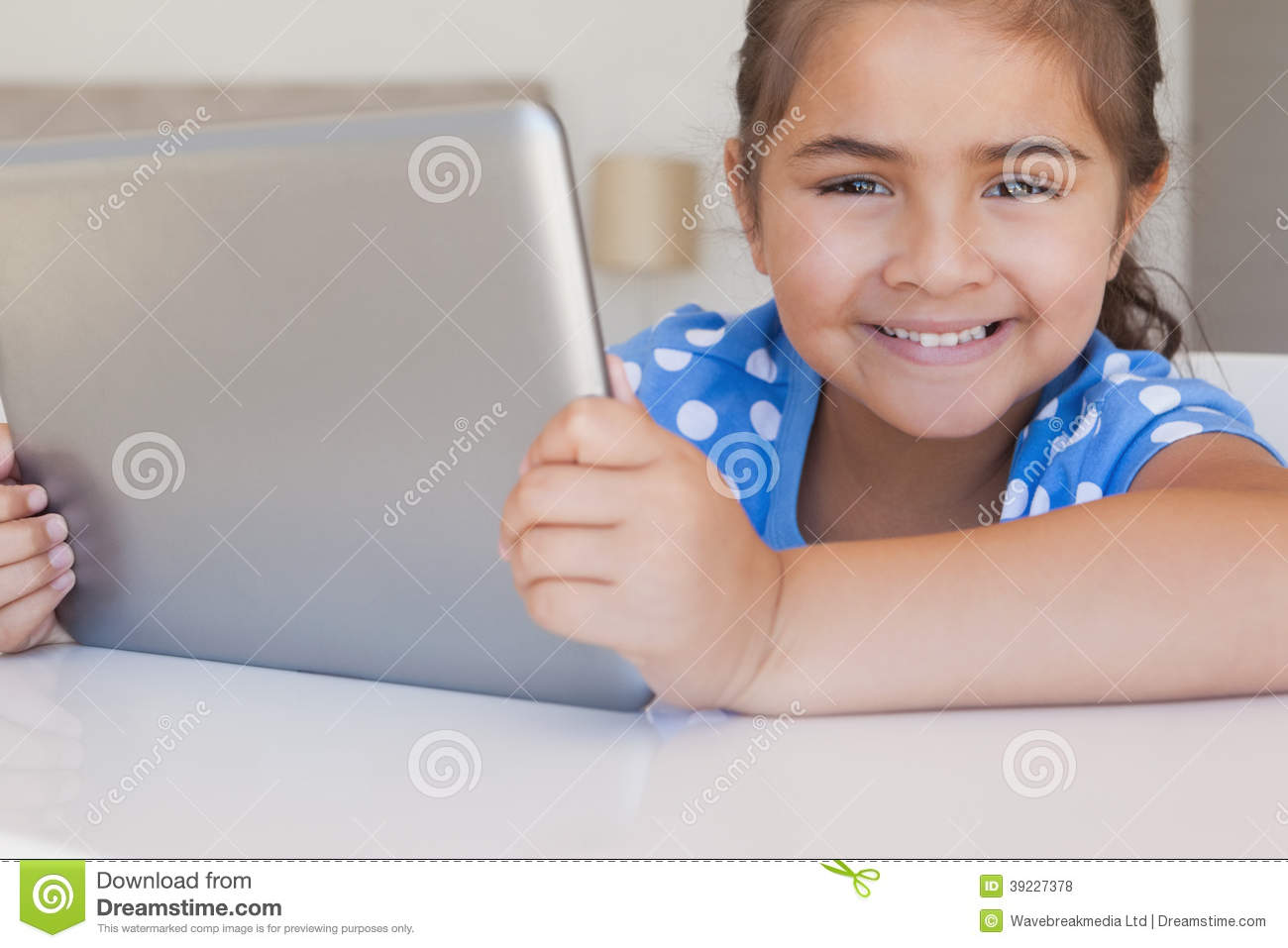 Close-up portrait of a girl using digital tablet