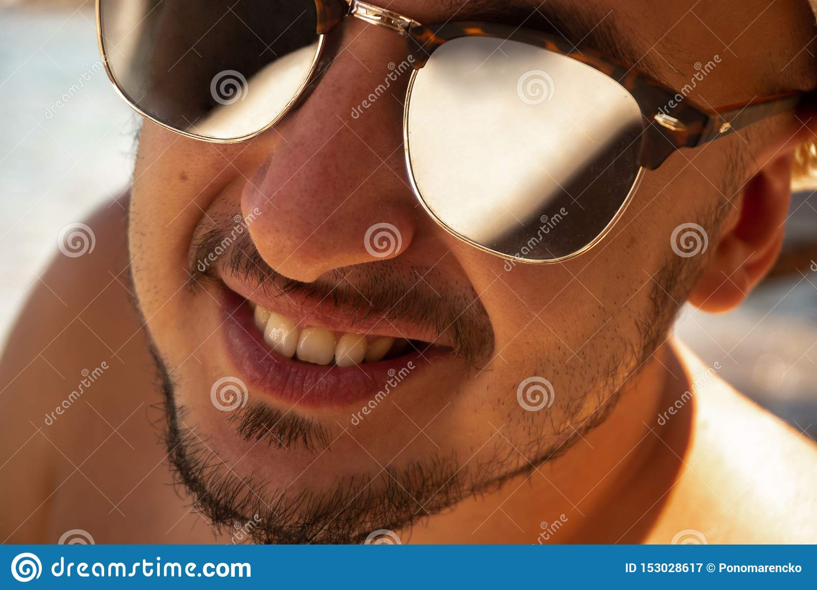 Close up portrait of a happy man in sunglasses