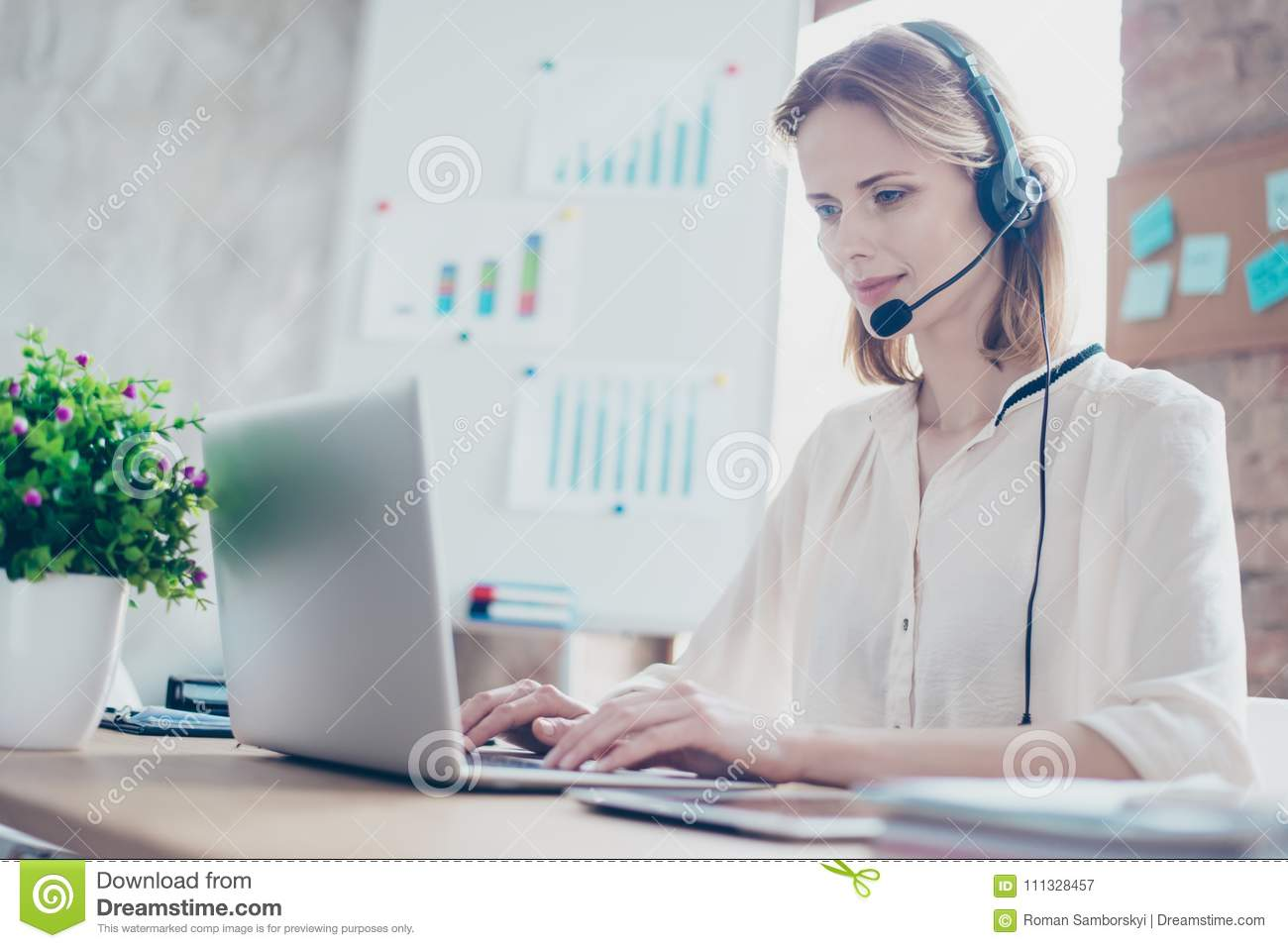 Close up portrait of happy smiling confident experienced qualified young professional operator of call center, she is sitting