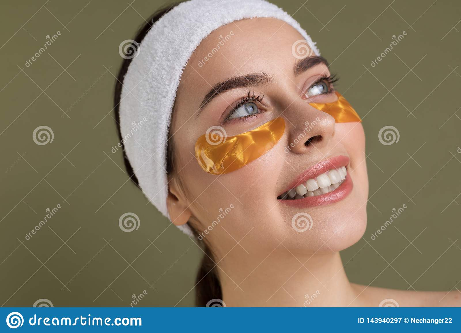 Close up portrait of happy smiling girl with patches under eyes from wrinkles and dark cicles
