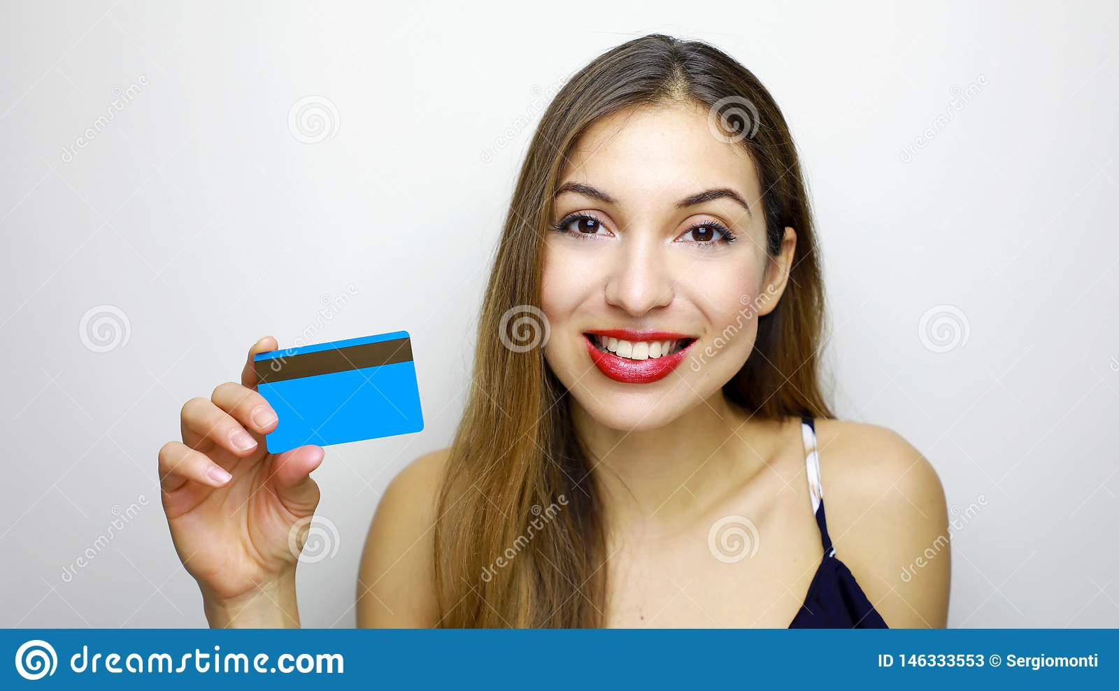 Close up portrait of happy young woman with showing credit card isolated over white background