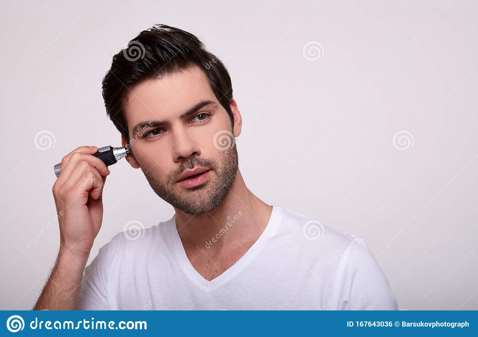 A Young White Guy Removes The Hair In His Ealone Slummer Stock Photo Image Of Caucasian Portrait 167643036