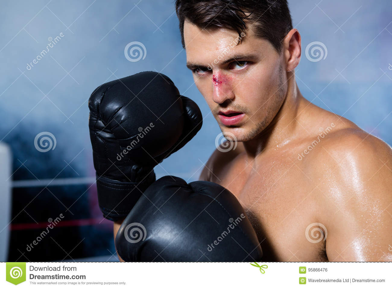 Close-up portrait of male boxer with bleeding nose