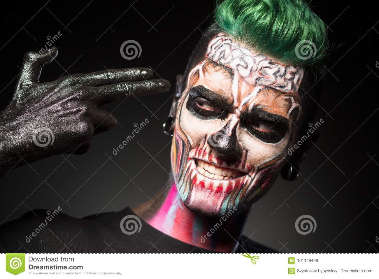 close up portrait of a man with mystical halloween makeup. stock
