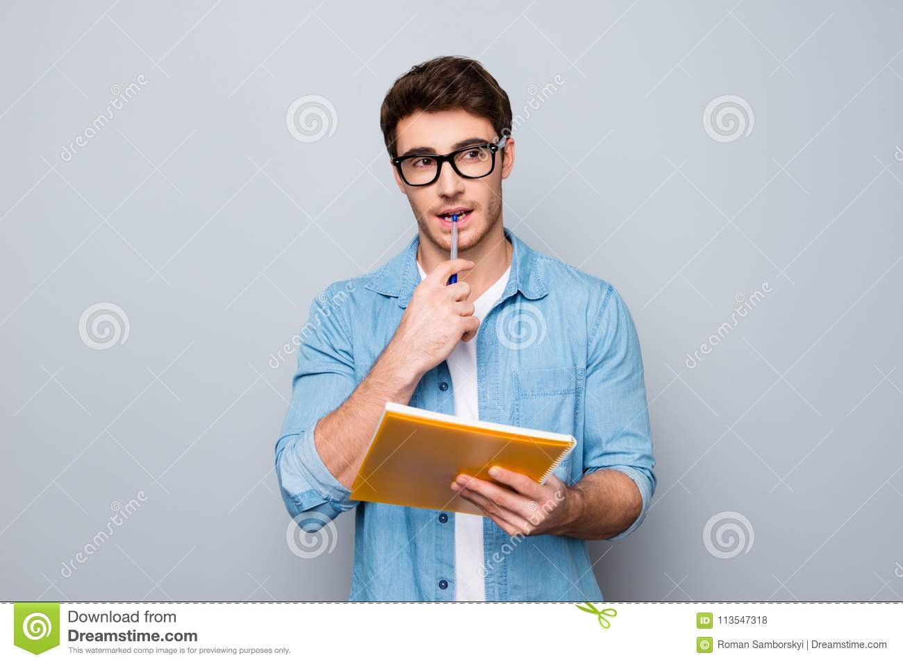 Close up portrait of pondering handsome lovely adorable cute smart clever attractive intelligent guy biting pen thinking how to so