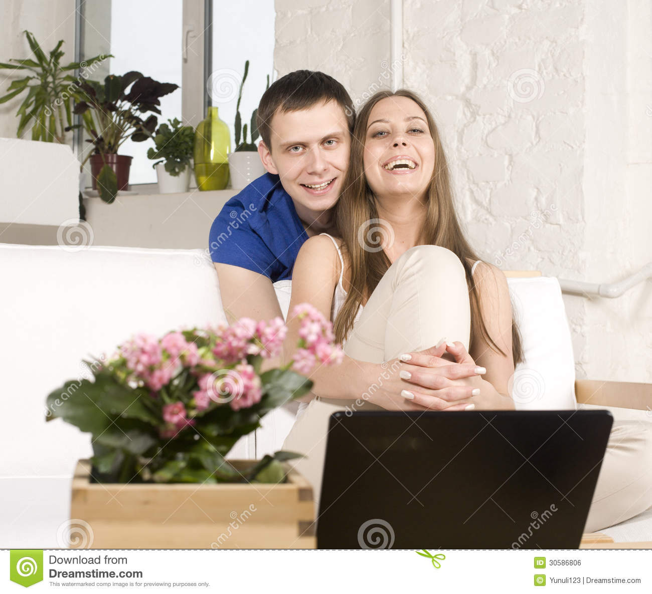 Close Up Portrait Of Pretty Young Couple. Man And Woman