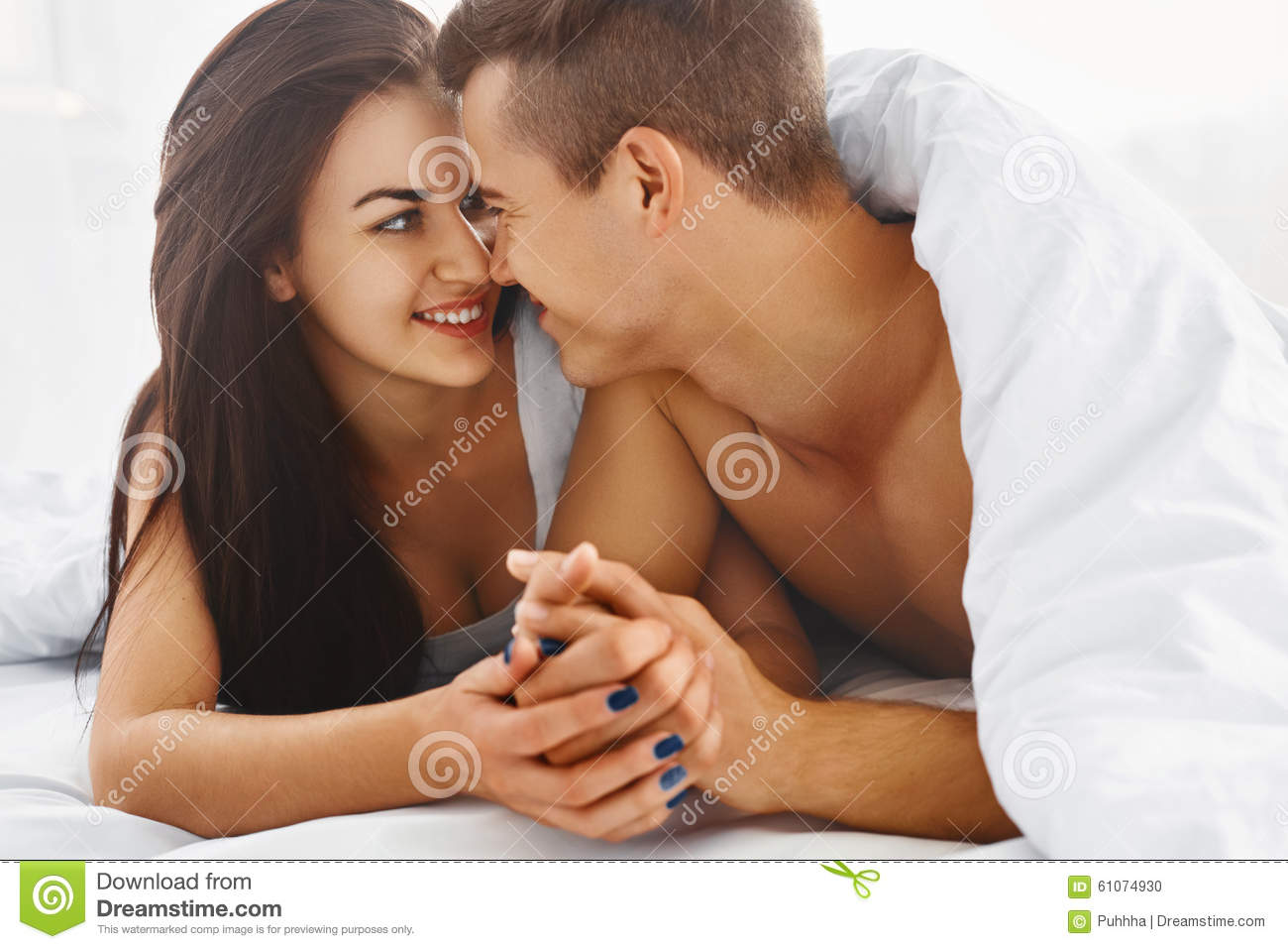 Close up portrait of romantic couple in bed stock photo for Love pictures in bed
