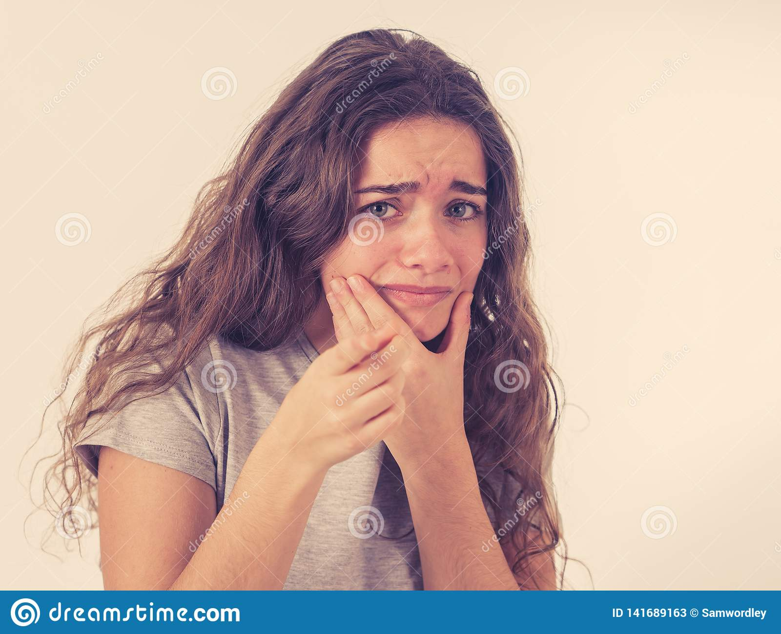 Human expressions and emotions. Young attractive teenager girl looking scared and shocked